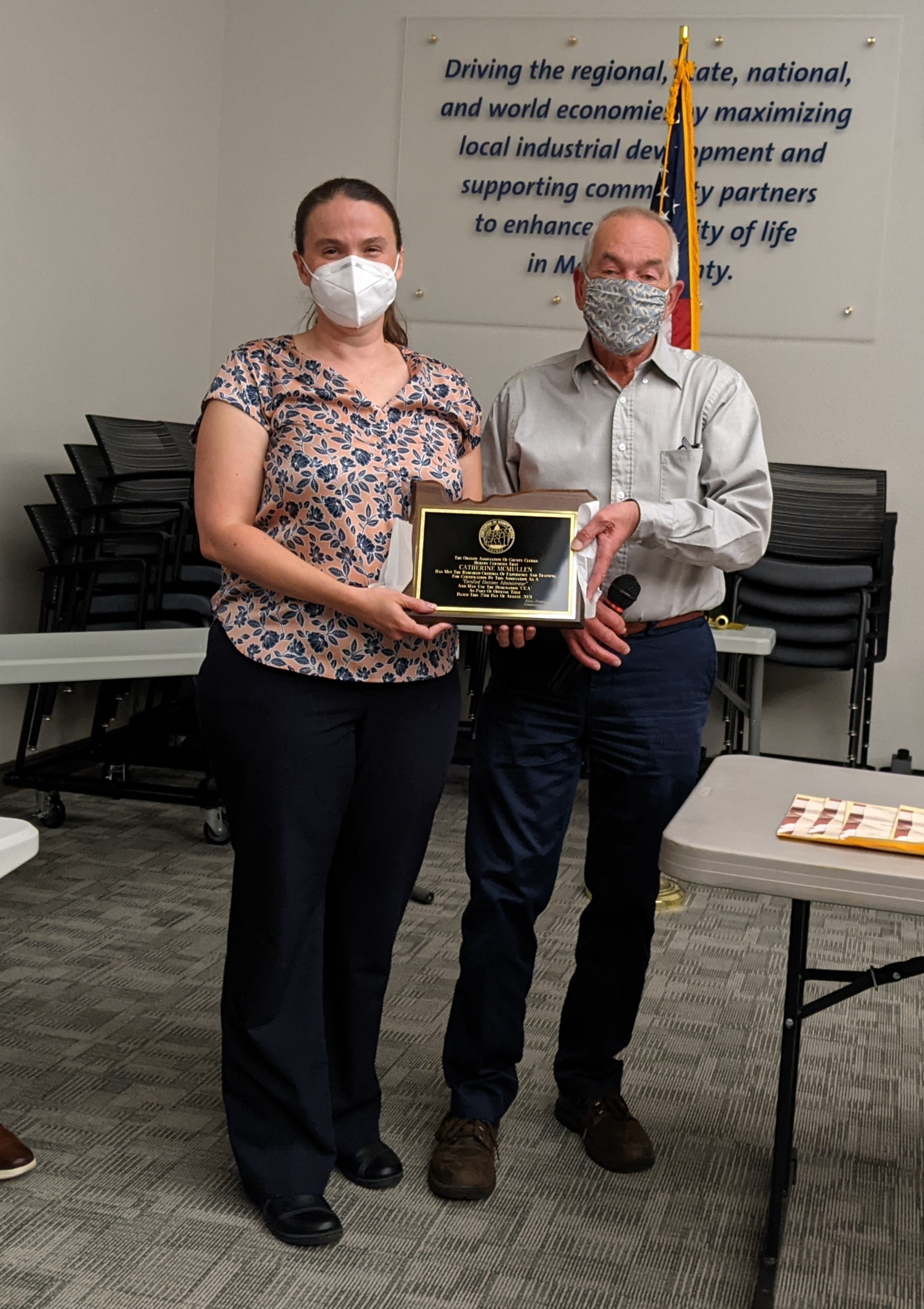 Catherine McMullen, CEA poses for a phone with Dana Jenkins, Lincoln County Clerk as she receives her certification plaque.